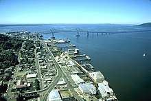 City of Astoria, Oregon in the foreground with the Astoria–Megler Bridge spanning the Columbia River to Washington State