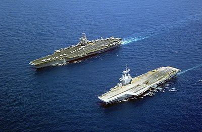 The French nuclear-powered aircraft carrier Charles de Gaulle and the American nuclear-powered carrier USS Enterprise (left), each of which carry nuclear-capable fighter aircraft USS Enterprise FS Charles de Gaulle.jpg