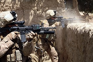 Operation Strike of the Sword - Image: US Marines firing M4s in Helmand province Afghanistan
