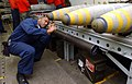 US Navy 030327-N-1328C-506 Aviation Ordnanceman 1st Class Gregory Williams tightens setscrews during the assembly of a bomb aboard USS Theodore Roosevelt (CVN 71).jpg