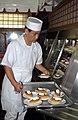 US Navy 031225-N-2101W-015 Toshiyuki Hiruta places pumpkin pie desserts in the cooler during Christmas dinner.jpg