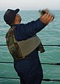 US Navy 040213-N-3725V-005 Culinary Specialist 1st Class Danny Miller, throws an anti-swimmer concussion grenade during training.jpg