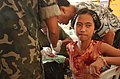 US Navy 040226-N-4142G-023 A young child receives medical aid from military personnel participating in the Medical Civic Action Program (MEDCAP) in Bargangay San Miguel as a part Exercise Balikatan 2004.jpg