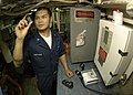 US Navy 050103-N-9079D-126 Engineman 3rd Class Steve Sengphachanh of Anderson, Calif., checks bromine levels on potable water.jpg