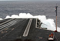 US Navy 050119-N-7130B-034 Water crashes over the bow of USS Ronald Reagan (CVN 76) as she steams through heavy seas in the Pacific Ocean.jpg