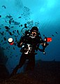 US Navy 050216-N-3093M-002 Photographer's Mate 2nd Class Chris Perez works with a digital underwater camera while conducting a navy scuba dive off the coast of Panama City, Florida.jpg