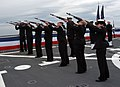 US Navy 050331-N-3390M-378 Sailors assigned to Ceremonial Rifle Guard, aboard the guided missile destroyer USS Momsen (DDG 92), render a 21-gun salute for a burial at sea ceremony to honor the passing of Capt. Charles Bowers Mo.jpg