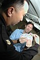 US Navy 050425-N-9389D-023 Rick Gerber, also known as Bud the Magician, performs a magic card trick for Master Chief Culinary Specialist Nestor Tumulac aboard the conventionally powered aircraft carrier USS Kitty Hawk (CV 63).jpg