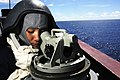 US Navy 050917-N-1332Y-020 Seaman Margarette Fajardo keeps a watchful eye out as portside lookout by searching for surface contacts through a telescopic alidade.jpg