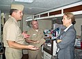 US Navy 051005-N-7231W-003 Capt. Michael Warner, shows donated goods to Commander, Task Force Navy Family, Rear Adm. Robert O. Passmore and Deputy Commander, Task Force Navy Family, Ms. Debra J. Edmond.jpg