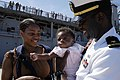 US Navy 060504-N-7092S-379 Ensign Omari Buckley greets his wife and gets his first look at his 4-month-old daughter after the dock landing ship USS Carter Hall (LSD 50) pulled into Naval Amphibious Base Little Creek.jpg