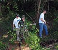 US Navy 060525-N-5324B-002 11 volunteers helping the Little Rock Parks and Recreation Department clear heavy brush at Connor Park in preparation for repairs to the levee of a 4 acre lake.jpg
