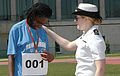 US Navy 070422-N-5215E-001 Midshipman 3rd Class Michelle Degrothy congratulates an athlete who won a gold medal in the Special Olympics at the Naval Academy.jpg