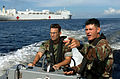 US Navy 070922-N-0194K-536 Lt.j.g. Mike Porfirio, left, and Master-at-Arms 3rd Class Pablo Ordonez conduct a security patrol in the waters around Military Sealift Command hospital ship USNS Comfort (T-AH 20).jpg