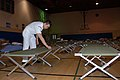US Navy 071023-N-5086M-023 Culinary Specialist 2nd Class Yan Ng prepares cots for potential evacuees during the San Diego wildfires, which have already burned more than 250,000 acres in San Diego County.jpg