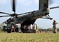US Navy 071201-M-3095K-140 angladeshi locals off-load food and supplies from a CH-53E Super Stallion.jpg