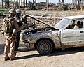 US Navy 071229-M-4746J-058 Marines with I Co., 3rd Battalion, 3rd Marine Regiment search a vehicle in Anbar Province.jpg