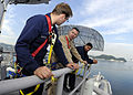 US Navy 081029-N-7280V-074 Capt. Thom W. Burke performs a maintenance spot check with Electronics Technician Seaman Brian Maples.jpg