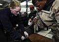 US Navy 081108-N-8534H-018 Electrician's Mate 2nd Class Melissa Allred demonstrates how to secure a chemical, biological and radiological (CBR) suit during a CBR drill aboard the Nimitz-class aircraft carrier USS George Washing.jpg
