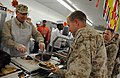 US Navy 081127-N-5549O-478 Secretary of the Navy (SECNAV) the Honorable Dr. Donald C. Winter serves Sailors and Marines Thanksgiving dinner during a visit at Camp Baharia, Iraq.jpg