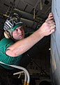 US Navy 081129-N-2456S-040 Aviation Structural Mechanic 3rd Class James Rhea, assigned to VAQ-141, tapes off the word.jpg