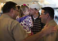 US Navy 090227-N-0184L-002 Hospital Corpsman 3rd Class Chad Martin reunites with his daughter at Corpus Christi International Airport after a 7-month deployment.jpg