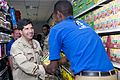 US Navy 090319-N-9552I-005 Rear Adm. Robert J. Bianchi, commander, Navy Exchange Service Command, greets a local Djiboutian Navy Exchange employee at the Navy Exchange at Camp Lemonier.jpg
