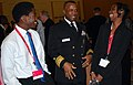 US Navy 090326-N-9268E-035 Rear Adm. Arthur Johnson speaks with high school students from Gainesville, Fla. during the National Society of Black Engineers conference in Las Vegas.jpg