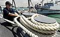 US Navy 090424-N-9928E-115 Boatswain's Mate Seaman Angelica Zielstorf, from Davenport, Iowa, wraps a mooring line around a bit on the forecastle aboard the Arleigh Burke-class guided-missile destroyer USS Kidd (DDG 100) as the.jpg
