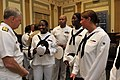 US Navy 090727-N-8273J-102 Chief of Naval Operations (CNO) Adm. Gary Roughead speaks with crew members of pre-commissioning unit Gravely (DDG 107) at the conclusion of a ceremony honoring the service of Vice Adm. Gravely.jpg