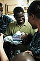 US Navy 100202-N-1525C-070 Antonio Jeanite is reunited with his three-month-old daughter, Christ-Yarah, aboard the Military Sealift Command hospital ship USNS Comfort (T-AH 20).jpg