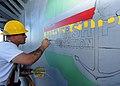US Navy 100202-N-6676S-002 Boatswain's Mate 2nd Class Jeffrey Dixon, from Baton Rouge, La., paints a mural of Africa aboard the amphibious dock-landing ship USS Gunston Hall (LSD 44).jpg