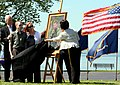 US Navy 100507-N-9093R-001 Daniel, John, and Maureen Murphy look on as artist Yoni Park reveals a portrait of Navy (SEAL) Lt. Michael Murphy.jpg