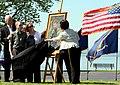 US Navy 100507-N-9093R-001 Daniel, John, and Maureen Murphy look on as artist Yoni Park reveals a portrait of Navy (SEAL) Lt. Michael Murphy.jpg