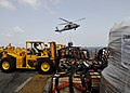 US Navy 100814-N-1226D-428 Lance Cpl. Michael Wertman moves cargo on the flight deck of USS Peleliu (LHA 5) during a vertical replenishment.jpg