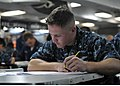 US Navy 100909-N-8113T-011 Operations Specialist 3rd Class Jonathan Schneider takes the Navy-wide E-5 advancement exam.jpg