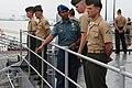 US Navy 110303-N-6692A-064 Capt. Aang Iskandar talks to Marines during the arrival of USS Germantown (LSD 42).jpg