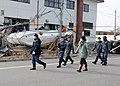 US Navy 110314-N-MU720-041 Masayoshi Sawaguchi, director of the Department of Policy and Finance for Misawa City, guides Sailors assigned to Naval.jpg