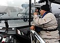 US Navy 110605-N-PM781-253 Gunner's Mate 2nd Class Gustavo Figueroa, assigned to Maritime Expeditionary Security Squadron (MSRON) 1, communicates w.jpg