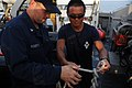 US Navy 111026-N-RP435-049 An explosive ordnance disposal diver shows Mineman 3rd Class James Roberts how to tie a quick release knot.jpg