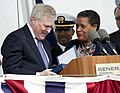 US Navy 111112-N-VY256-257 Secretary of the Navy the Honorable Ray Mabus receives a family heirloom from Myrlie Evers-Williams.jpg
