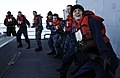 US Navy 111202-N-BC134-209 Sailors aboard the guided-missile cruiser USS Bunker Hill (CG 52) pull a communication line from the Military Sealift Co.jpg