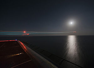 US Navy 120111-N-DR144-083 An F-A-18 Hornet launches from the flight deck aboard the Nimitz-class aircraft carrier USS Carl Vinson (CVN 70).jpg