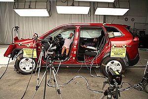 Out of position (crash testing) - Two crash test dummies inside a Jeep Cherokee after an out-of-position side airbag test.