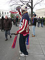 Vendor in red white and blue waving souvenir tickets Inauguration 2013.jpg