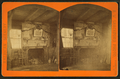 View of a fireplace and rifles above, Farmington, N.H, by A. W. Shackford.png