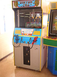 An arcade cabinet with two gun controllers