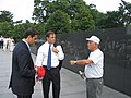 Vito Fossella and Andrew Lanza talk with a Korean War Vet from Staten Island.jpg