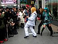 Vocaloid cosplaying band including Hatsune Miku, in Akihabara Station Center Square (2008-03-01 14.34.20 by Tamaki Sono).jpg