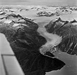 West Twin Glacier, terminus of tidewater glacier, banded ogives, and an icefield in the background, August 27, 1969 (GLACIERS 6318).jpg